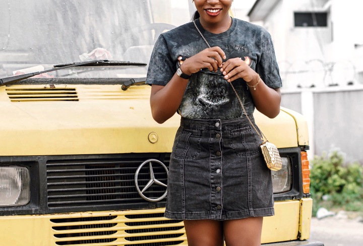 Topshop, denim skirt, black denim skirt, gold strap sandals, tiger eye, gold purse in Nigeria, how to style a denim skirt, how to style a body suit, aratribe, fashion blogs in Nigeria, vintage shirts, retro inspired outfits